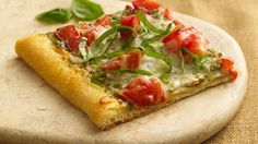 Tomato Pesto Pizza   Ready-made basil pesto lends classic Italian garlic-and-herb flavor to this pizza that steps outside the box!