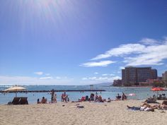 Waikiki beach with many people as usual.