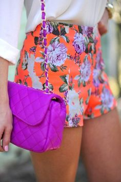 Orange and purple floral shorts, White chiffon blouse & Purple bag
