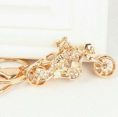 """Motorcycle Handbag Charm Gold toned skeleton shaped motorcycle handbag charm and keychain with rhinestone accents, front wheel rotates, bike measures approximately 2.5"""" Accessories Key & Card Holders"""