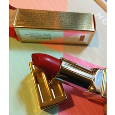 NWT Elizabeth Arden Lipstick  Brand new Elizabeth Arden Beautiful Color Moisturizing Lipstick! In the shade 02 Red Door Red! Super gorgeous classic red! Full size! Retails for $25, no trades! The box on one side is a little dinged up, shown in picture. Elizabeth Arden Accessories