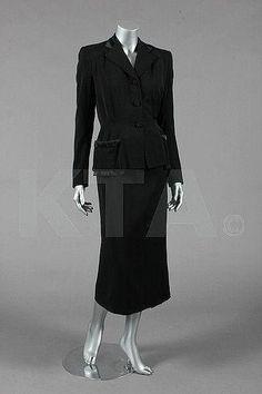 A Digby Morton black wool suit, circa 1950