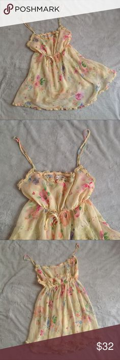 Vintage 90s Victoria's Secret Floral Ruffle Slip Beautiful vintage (I believe, circa 90s, based on label and style) slip/chemise by Victoria's Secret. Lightweight yellow chiffon with abstract watercolor pink floral print. Cinches in at waist with elastic and has ruffle detail at neckline and hem. Lower neckline in the back. Adjustable straps. Size medium, see photos for measurements. Excellent used condition. Victoria's Secret Intimates & Sleepwear Chemises & Slips