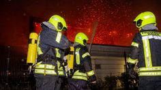Firefighters in Nauen near Berlin work to put out a fire at a local gymnasium....