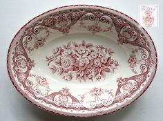 Here's a pretty English Staffordshire transferware serving bowl by Swinnerton's in the Kent pattern. I love the Shabby & Chic look of this one. It has a cluster of roses and flowers in the center, sur