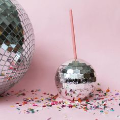 Disco Ball Tumbler. This silver metallic with a pink straw tumbler is perfect for hot or cold drinks.