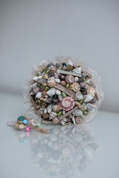 Brides shell bouquet and shell buttonhole. Products created by Wild Floral Designs, photographed by Georgina at Panache photography all rights reserved Alternative Bouquet, Alternative Wedding, Shell Bouquet, Floral Designs, Buttonholes, Wedding Designs, Brides, Create, Photography