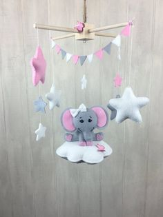 The mobile can be defined as moving sculpture. Early mobiles did not necessarily move, as do most crib mobiles today. The modern crib mobile is… Baby Crib Mobile, Baby Cribs, Baby Mobiles, Star Mobile, Cloud Mobile, Elephant Mobile, Elephant Baby, Diy Décoration, Felt Crafts