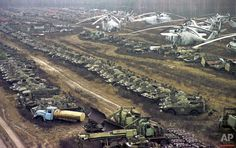In this Nov.10, 2000 photo, radioactive contaminated vehicles lay dormant near the Chernobyl nuclear power plan. Some 1,350 Soviet military helicopters, buses, bulldozers, tankers, transporters, fire engines and ambulances were used while fighting against the April 26, 1986 nuclear accident at Chernobyl. All were irradiated during the clean-up operation. Thirty years ago, the Chernobyl Nuclear Power Plant exploded in Ukraine, spreading radioactive material across much of the Northern…