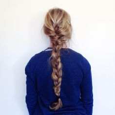 Extra long, somewhat mussed and messy, braid. | Looks about right for having been self-styled.