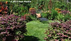 The lawn in this garden is whittled down to a throw-rug size, just enough to cool the toes and set off the garden beds. Nichols Garden: San Francisco Garden Bloggers Fling | Digging