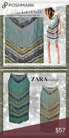 SALE 🎉 HP Zara sequin fringe Charleston dress Fabulous Zara Trafaluc sequins dress.  Fringe neckline and bottom hem. Adjustable spaghetti straps. Size small. great condition. There are no missing sequin that I can find. Worn 2 times. NO TRADES PLEASE! REASONABLE OFFERS WELCOME THROUGH OFFER FEATURE ONLY PLEASE! 21245 3261740.   FIRM PRICE UNLESS BUNDLED, NO OFFERS Zara Dresses