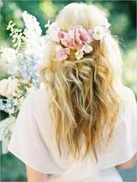Gorgeous waves, on hair worn long and loose with a crown of flowers, perfect hair for a rustic or summer wedding.