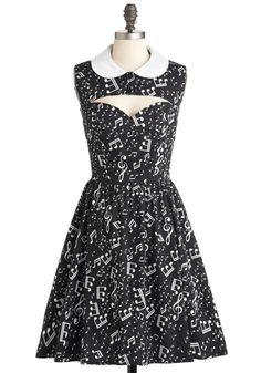 This dress is GREAT. Love it! Only wish it were colorful instead of black. Music notes & cute sweetheart neckline-cutout.  Ooh La La-capella Dress | Mod Retro Vintage Dresses | ModCloth.com