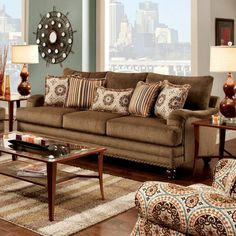 ADDERLEY SOFA- SM8460-SF DESCRIPTION : Love the bold and traditional appeal of this sofa and love seat set. This distinctive sofa set features beautiful sculptural silhouette that offers a supportive pillow back and a plush seat cushion, resulting in a very comfortable sit. It's also a great decorative element, thanks to the nailhead-trimmed base, decorative throw pillows and tall wooden legs. Matching accent chairs available. Features : Transitional Style Modern English-Arm Style Loose…