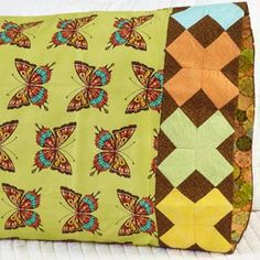 Fabric: Flutter by Ro Gregg for Paintbrush Studio. Pillowcase Pattern 24. Free download here: http://www.allpeoplequilt.com/millionpillowcases/freepatterns/index.html