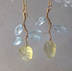These earrings have a rustic yet glamorous look. The colors are pastel blue and yellow with metallic gold. They can be worn for dressy or