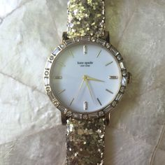 Kate Spade Ladies Gold Glitter Watch 100% authentic Kate Spade glitter glam gold watch features alternating baguette and round crystals on the bezel. Comes to you new in box with manual. kate spade Accessories Watches