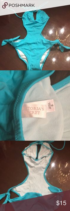 Victoria's Secret cut-put swimsuit I just found this is my closet! Never worn. NWOT and still has the hygienic liner in it. They sent me the wrong suit by accident. It's turquoise in color. No padding. Victoria's Secret Swim One Pieces