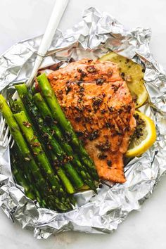 Easy, healthy, garlic herb butter salmon and asparagus foil packs are a quick and tasty 30 minute meal for summer nights, camping, and cookouts. The flaky salmon and tender asparagus will melt in your mouth! Salmon Recipes, Fish Recipes, Seafood Recipes, New Recipes, Salmon Meals, Dinner Recipes, Healthy Grilling Recipes, Healthy Eating Tips, Cooking Recipes
