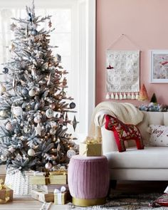 Pink Christmas inspiration with pink wall and rose/gold bottle brush tree as well as a pink ottoman - Target. Pink Christmas Decorations, Holiday Decor, Rusty Cast Iron Skillet, Pink Ottoman, Pink Paint Colors, Gold Bottles, Shabby Chic Pink, Bottle Brush Trees, Pink Walls