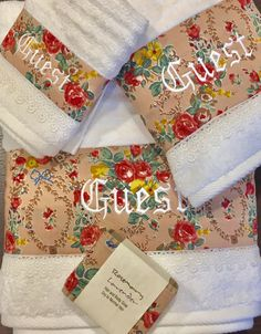 Rose Garden Embroidered Towel Set. Luxurious soft and absorbent white towels. Feels like 100% cotton. Made of 90% cotton and 10% polyester. Elegantly decorated with a rose print fabric and trimmed with a beautiful white lace. Personalize it with a monogram, name or favorite word.