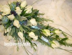 Trailing bouquet of roses and paua shell for a NZ style wedding