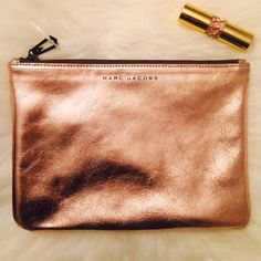 Rose Gold Marc Jacobs Makeup Bag Rose Gold Marc Jacobs Makeup Bag from the NEIMAN MARCUS collection at target. Brand new without tags. Size 7X10 NO TRADES. XOXO Marc Jacobs Bags Cosmetic Bags & Cases