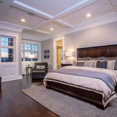 Cozy master bedroom.  Love the bed and the rug