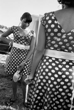 Singers in polka dot dresses attend the Greenville Blues Festival, the second oldest continuously operating blues festival in the United States held in Greenville, Miss.