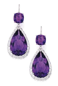PAIR OF AMETHYST AND DIAMOND PENDANT-EARRINGS Set with two pear-shaped amethysts weighing approximately 21.00 carats and two cushion-cut amethysts, framed by round and old European-cut diamonds weighing approximately 2.75 carats.