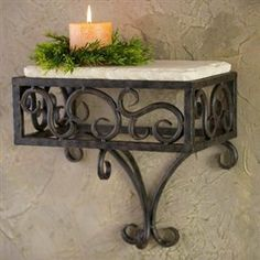 Wrought Iron Siena Wall Shelf by Bella Toscana. $201.95. Ships in 5-10 Business Days. In the style of Siena in Tuscany comes this beautiful shelf that will transform even the most boring wall into a stunning work of art. Place this in a room with other touches of Tuscany, and you will have visions of Italian villas dancing in your head. Hand-forged wrought iron has been carefully crafted to create a truly remarkable shelf base, with its beautiful curves and perfect joints...