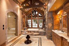 Luxurious bathroom in a timberframe home. Locati Architects