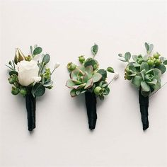 The groomsmen sported green boutonnieres with succulents and unripened blueberries to honor the bride's late father.