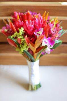 Tropical Bouquet... Love the idea of incorporating bird of paradise