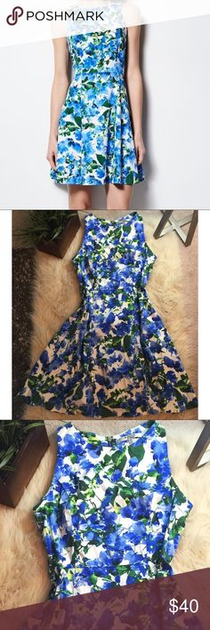 """FLASH SALE 🛍🎉Milly floral fit and flare dress Milly for designation- gorgeous cotton fit and flare dress. Sleeveless blue floral dress is beautiful dressed up or down. Perfect condition/ no flaws. Exposed zipper  in the back. Dress is a size ten, approx 34"""" long, 16.5"""" under arm to under arm. Milly Dresses"""