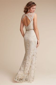 A scalloped neckline, sheer lace back, and waist-defining silhouette make this gorgeous gown a stunning option for the classic and feminine bride. Graphic lace and floral accents add texture and a whisper of romance. #shopstyle#ad
