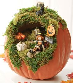 Use a fake pumpkin to make a spooky or cute diorama to use every year