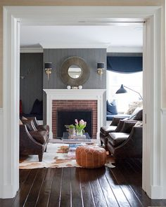 Design firm Delicious Designs featured Oxford Weave 4483 Indigo blue in the library & den area of a client's home.