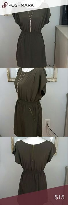 "Army green dress Cute little army green dress 100% polyester. Zipper pockets. Bust is approximately 36 in. Waist stretches to about 28"" and length is about 17"". one clothing Dresses"