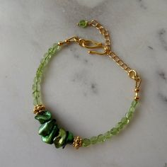 Genuine Peridot bracelet, August birthday, genuine gemstones and keshi pearls, ethical jewellery, green pearl bracelet, pale green jewelry. Handmade in the UK by CalicoRoseStudio. Limited edition of 4 bracelets only. £25.50