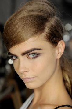 smoky eyes are a doorway to a sexy make up look for any event. And note, brows are gonna stay big for 2013!  #love Cara
