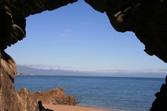 A cave with a view onto the azur ocean in the Abel Tasman National Park.