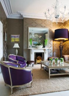Purple leather French chairs and the metallic taupe wallpaper...I like !!