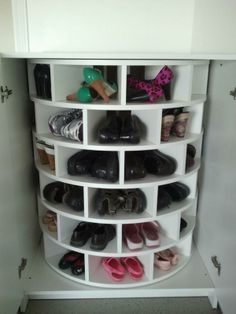 Perfect way to keep the shoes out of the way at the front door. Build lazy suzanne cabinet.