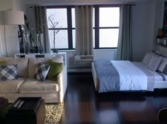 """Use a rug to create a living space. It differentiates that area from the """"bedroom"""" area."""