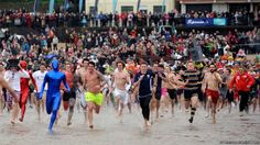 Over 650 swimmers take part in the Tenby Boxing Day Swim, making it a record year for the fundraising event. Christmas And New Year, Christmas Fun, Stag And Hen, Boxing Day, Keep Cool, Fundraising Events, Swimming, Photo And Video, Unusual Things