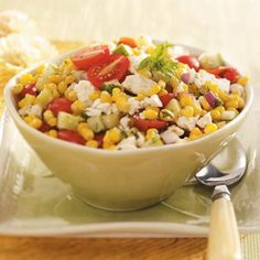 Summer Corn Salad Recipe -This beautiful salad truly captures the summer season. It's chock full of fresh veggies and basil, and feta cheese gives it a rich, tangy flavor the whole family will love. —Priscilla Yee, Concord, California