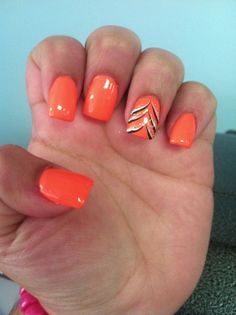 nice bright orange nails with another simple but cool design