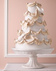 This romantic wedding cake, adorned with gum paste ribbon and doves, feels straight from a fairy tale